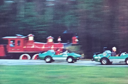 Walt Disney World Grand Prix cars race train