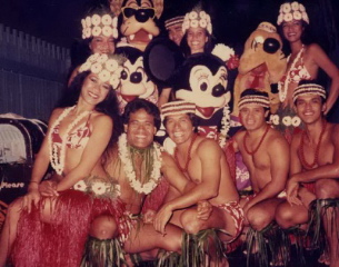 Polynesian Luau cast members with Mickey and Minnie